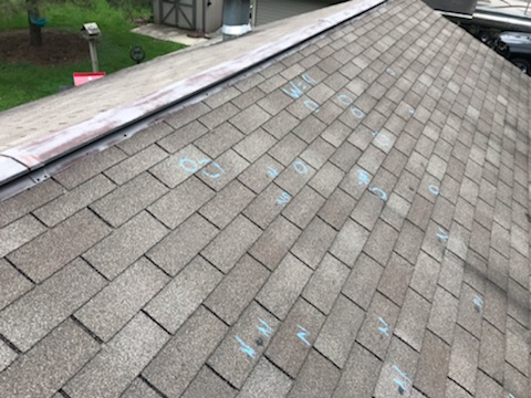 Roof with marked damage spots